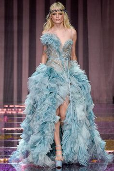 Donatella's vision of couture is next level—I can't wait to see this Atelier Versace gown on the red carpet somewhere glamorous, like the Venice Film Festival.