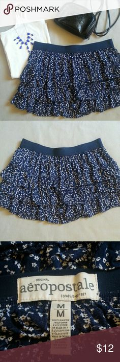 Aeropostale Floral Mini Skirt Adorable floral skirt is perfect for summer! It has a blue and white floral pattern, three layers of ruffles, and an elastic waistband. Aeropostale Skirts Mini