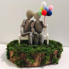 Handmade pebble art statue. #unique #oneofakind #love #bench #balloons #couple #forever #moss #tree #pebbles #pebbleart #statue