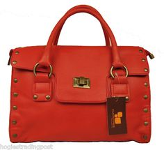 BEAUTIFUL CORAL RED DESIGNER LEATHER HANDBAG BY PUNTOTRES  Made in Spain  The attention to detail and quality of finish on this stunning leather handbag is exquisite.  Colour: Coral red  Fabric: Leather  Interior: Woven 'Puntotres' orange fabric lining  Inside authenticated with a 'Puntotres' Antique brass embossed logo plate stamped with 'Puntotres - Genuine LEATHER  BRAND NEW  £99.00