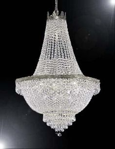 This beautiful Chandelier is trimmed with Empress Crystal(TM)  <br>100% CRYSTAL CHANDELIER, this chandelier is characteristic of the grand chandeliers which decorated the finest Chateaux and Palaces a...