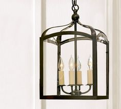 Love this lantern. Now if i can just think of someplace to hang it...maybe a pair over a dining table?