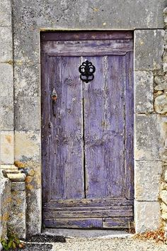 Lavender door...click on the source to see a fantastic collection of window and door photos.