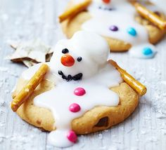 Melting snowman biscuits. Get little ones in the kitchen to assemble these cute festive biscuits - sticky fun for a wintry afternoon.