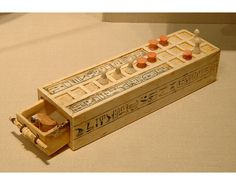 "Ancient Egyptian ""Game of twenty spaces"". Quite often, this board is on the back of the box dedicated to the game Senet."