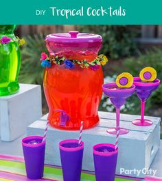 Quick, easy and island inspired cocktails will be a hit at your party! These fun color-changing tumblers and cocktail glasses change from pink to purple with any cold liquid! For your drink dispenser, we love the vibrancy of blood orange Italian soda, fresh orange slices and ice. Craving summer cocktails? In a shaker with ice, shake 4 oz. of your orange drink with 2 oz. of your Spirit choice, per person. Salt the glasses, strain the drink and pour, finish by adding more ice. Let the Luau…