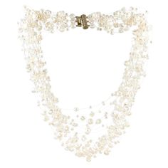 Floating multi-strand necklace to go with any gown on your special day. Can be worn twisted or loose. Priced upon request.