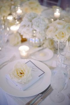 glam white and cream and silver wedding table