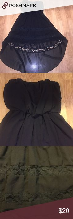 Stunning black strapless high low dress Perfect dress! Black high low strapless dress. Beautiful lace detail at the bottom. I love this dress but I wear scrubs everyday and don't have many opportunities to wear it. I have only worn once and had so many compliments on it. Bought at local boutique Double Zero Dresses Strapless