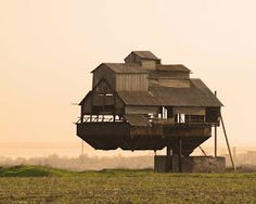Setting aside the physics required to hold this cantilever barn up.....I can't decide if it reminds me of a sand crawler, or Howl's castle.
