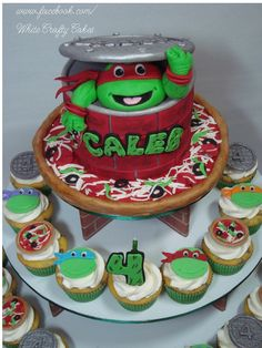 TMNT Cupcake Tower - A smaller version of my TMNT cake with Caleb's favorite turtle (Raphael), for on top of a cupcake tower.  I also made 48 cupcake toppers, (mini pizzas, sewer lids with the number 4, and the four different turtles).  Thank you so much for looking!