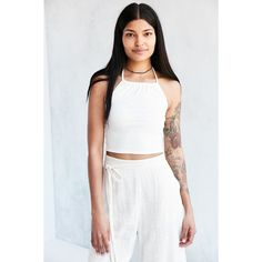 BDG Lea Halter Top ($9.99) ❤ liked on Polyvore featuring tops, halter-neck crop tops, white crop top, halter-neck tops, tie halter top and backless crop top
