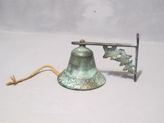 Vintage Brass Door Bell with Faux Verdigris Patina / Country Store Doorbell Door Chime, Ship Bell, Rustic Old Fashion Wall Mount Dinner Bell by MilkaCervenka on Etsy https://www.etsy.com/listing/251002720/vintage-brass-door-bell-with-faux