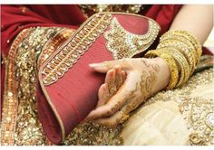 A trendy beautiful purse completes the outfit of a bride.