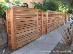 Horizontal fence with varied plank sizes.