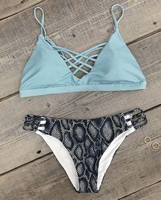 Not only does it make you cooler in the summer heat, it also gives just a hint of leg! Try a halter swimwear in contrast color. Lace up design and High leg cut will reveal your perfect skin. Oooh la la!