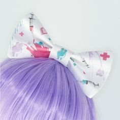 Fairy Kei Pastel Nurse Guro Lolita Syringe Hair Bow Headband. $14.00, via Etsy.