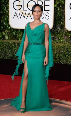 Jada Pinkett Smith The Gotham alum worked her assets in a jade, draped Atelier Versace dress, complete with caped sleeves and a thigh-high slit. Matching Jimmy Choo platforms completed the ensemble.