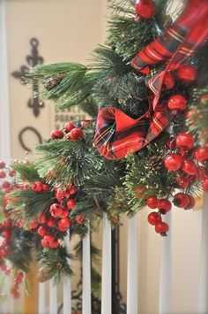 The banister is all aglow with glittery tartan & Red.....