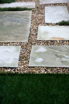 Sandstone paving slabs filled with gravel and artificial lawn as play surface #artificiallawn #gravel #peashingle #london