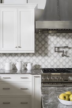 The Evolve pattern featured on Carrara marble, can be used as a backsplash or bathroom tile floor. Designed by Brianna Michelle Interior Design in Florida. Builders are Christopher Ryan Home Builders