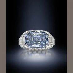 This 5.3 carat blue diamond sold for $9,600,000 at Bonhams' Fine Jewellery sale in London. It's set horizontally in a Trombino ring pave-set with brilliant- and baguette-cut diamonds created by Bulgari circa 1965.