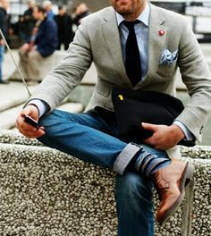 Excellent style using jeans, fun patterned socks, sport coat, lapel pin, pocket square, and textured tie.