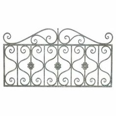 """Evoke intricate garden gates with this lovely scrolling wall decor, an eye-catching addition to your living room or foyer.  Product: Wall decor Construction Material: MetalColor: GreyFeatures: Distressed finishDimensions: 24"""" H x 27"""" W x 0.5"""" D"""