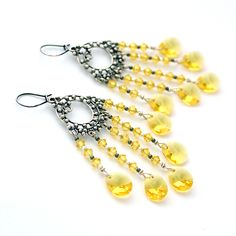 Sun chandeliers. Sparkling Swarovski crystals, silver. Long stunning earrings, perfect for summer.