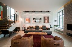 love love those leather chairs with the pull on the back. 100 Modern Interiors - UltraLinx
