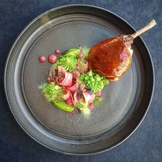 "Slow cooked duck leg marinated with ""LEMON & GARLIC WITH PINK PEPPER CORNS"" spice mix, rhubarb and romanesco."