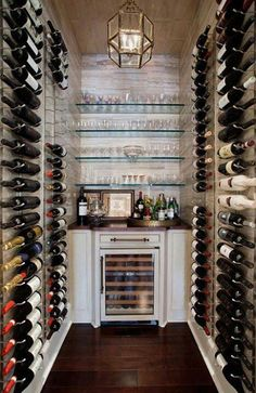 Floor to ceiling wine cellar.  This would house many okanagan valley wine bottles!
