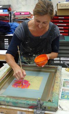 Emma painting a rose motif directly onto the silkscreen - Ochre Print Studio