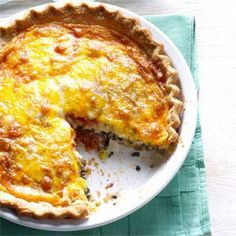 Tomato Olive Quiche Recipe Main Dishes, Breakfast and Brunch with pie pastry, all-purpose flour, salt, pepper, tomatoes, olive oil, eggs, heavy whipping cream, shredded sharp cheddar cheese, pitted olives, sweet onion, green onions, provolone cheese