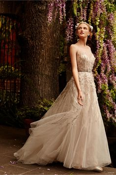 BHLDN wedding dress spring 2015. Inspired by an opulent garden. From pretty floral motifs to delicate lace and airy silk, the new collection is a dream for any bride looking forward to her big day. Pair with strappy heels or vintage inspired headpieces for a traditional wedding day look.