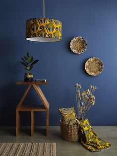 Bassa tables, Large Kenema lamp shade and baskets from Antakya on the walls of Culture African Crafts, African Home Decor, African Bedroom, African Interior Design, African House, Interior Design Programs, Home Decor Baskets, Commercial Interior Design, Dream Decor