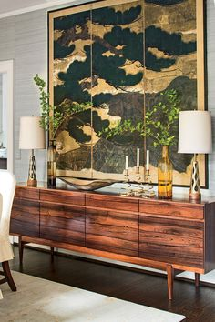 Shop the room: Danish Modern sideboard: Galaxie Modern, Lynchburg, VA. Blanc de Chine vase and pedestal: Parc Monceau, Atlanta. Charcoal: by Peter Roux. Table and chairs: Mrs. Howard, Atlanta. Rug: Stark. Grass cloth wallpaper: Phillip Jeffries