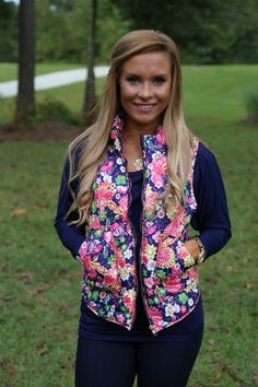 navy floral puffer vest   online women's boutique   free shipping
