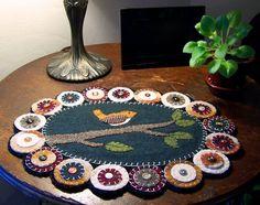 Reclaimed Wool Felt Bird on Branch Table Mat. $40.00, via Etsy.