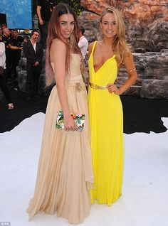 Fashion off: Model Amber Le Bon stunned in her ballgown as she greeted Kimberley Garner, who wore a vibrant yellow plunging dress