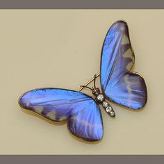 An Austrian gold-mounted diamond-set butterfly brooch, with natural butterfly wings under glass, 1866. (These butterfly wing pieces must have caused untold damage to the butterflies' worlds.)