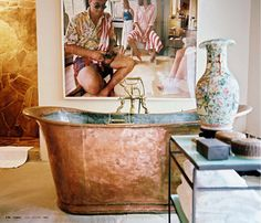 I have long fantasized about a copper soaking tub, but I've never seen one like this.  I'd probably have to sell the house to acquire the tub.