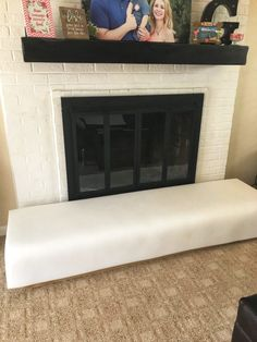 DIY: Baby Proofing Your Brick Fireplace - thisaveragemom Fireplace Seating, Brick Fireplace, Childproof Fireplace, Baby Proof Fireplace, Hobby Lobby Fabric, Toddler Proofing, Insulation Board, Upholstery Foam, Childproofing