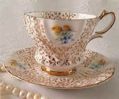 Queen Anne Gold Chintz China Tea Cup and Saucer Teacup Set