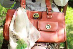 Orange purse and a scarf