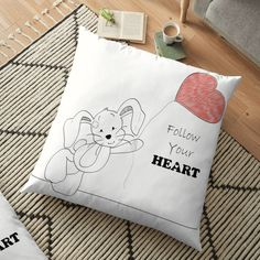 If a full redecorating project isn't in your budget, consider this inexpensive idea to give your room new life.Liven up your living room or bedroom with throw and floor pillows! Floor Pillows, Throw Pillows, Heart Balloons, Follow Your Heart, Pillow Design, Hare, Wall Tapestry, Duvet Covers, Living Room Decor