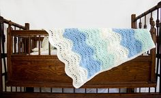 This crocheted baby blanket is sure to become your personal addition to your family heirloom chest. Each blanket is carefully crafted by hand while listening to the lull of a creaking wooden rocking chair. If youre like us, you miss the personal touch and are looking for the perfect pieces for a curated, been-in-the-family-for-ages look to provide the most comfortable environment for your new little one. This blanket adds that perfect touch!  ||Item Details||  length x width: approximately…