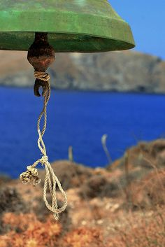 Green bell closeup view. Astypalea island, Dodecanese islands, Greece