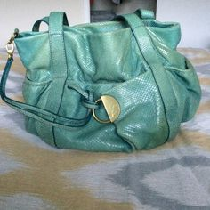 """Kooba """"snakeskin"""" bag Color- teal. Leather. Gold hardware. Definitely loved. There's wear on the straps. The bag has faded over time. But it still has a lot of life left. Tons of pockets! Outside pockets all around. One zippered pocket inside. Comes with dust bag. Kooba Bags"""
