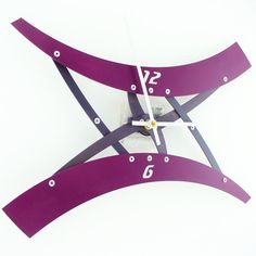 This guy does some of the most interesting metal wall clocks out there. Check out his work!    Sweep III Modern Wall Clock Aubergine Custom by All15Designs, $46.00